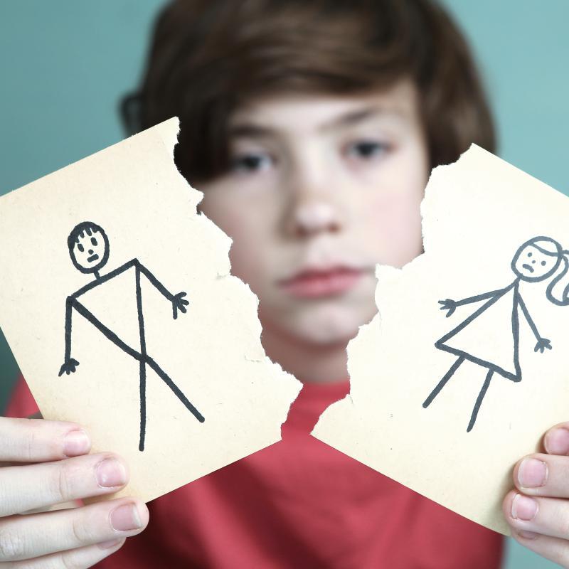 Boy Holding Paper Parents Divorcing