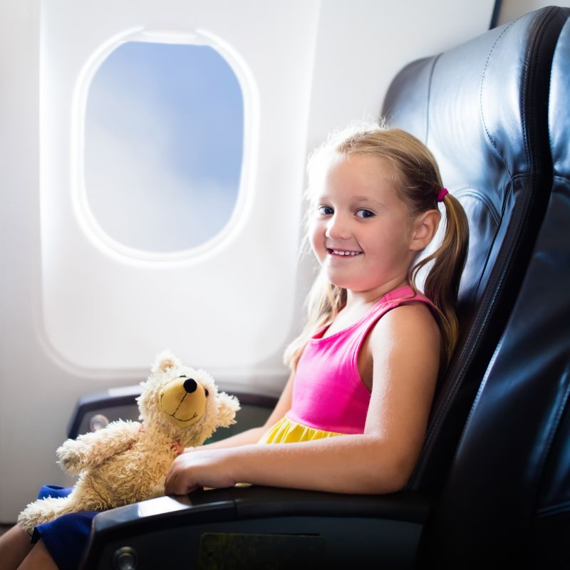 Child in Airplane on Vacation