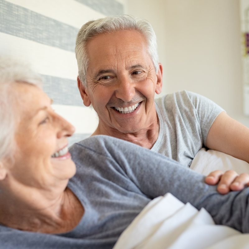 Happy Senior Couple in Bed