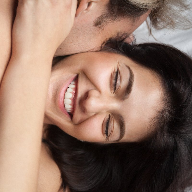 Husband Hugging Wife in Bed