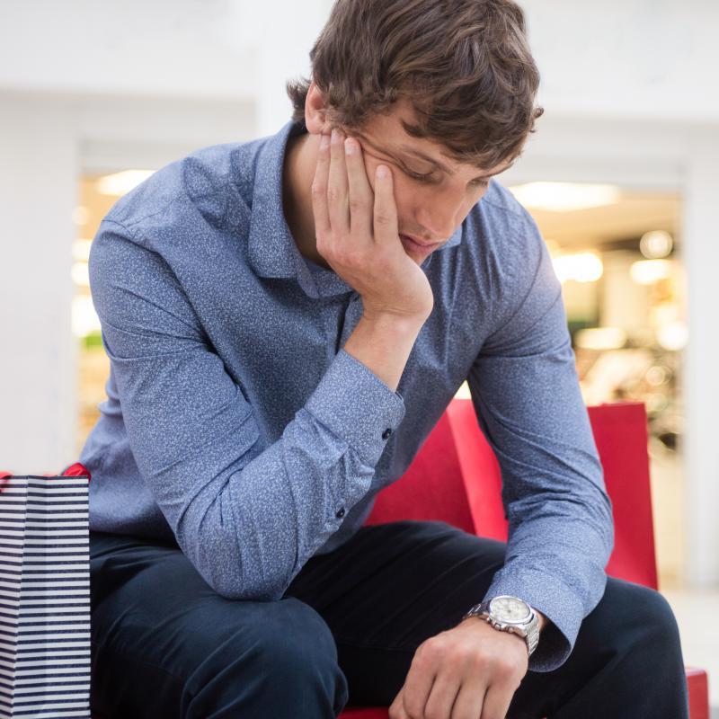 Man Sitting in Shopping Mall
