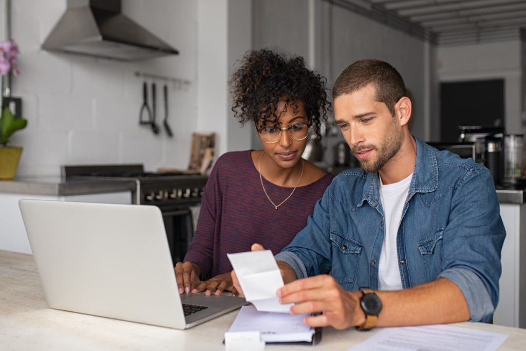 Married couple reviewing finances and paying bills