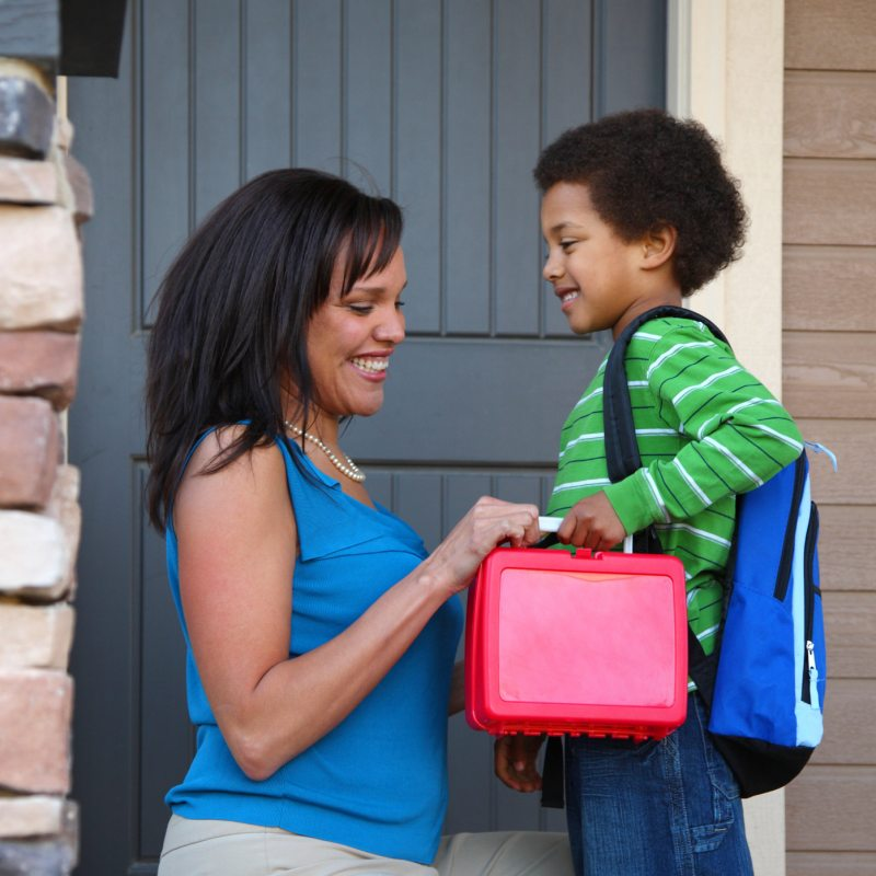 Mother Gets Child Ready for School